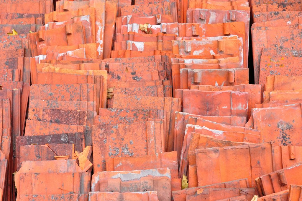 Stack of red ceramic roof tiles