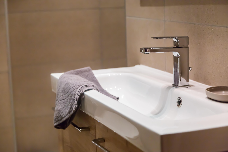 Bathroom interior with towel, copy space, closeup