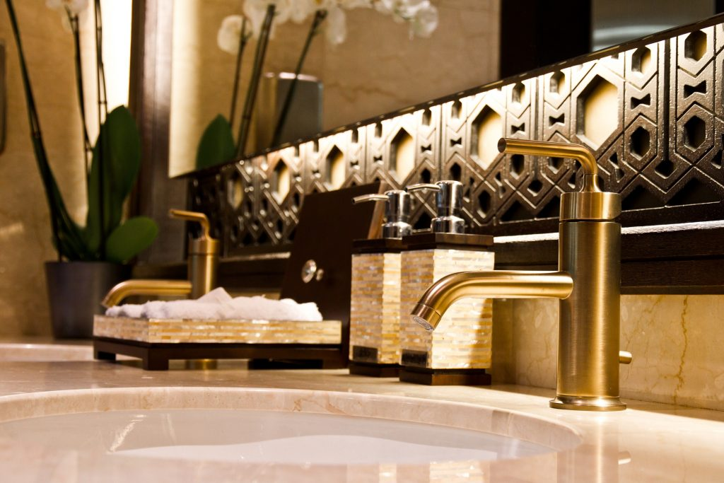 Elegant gold sinks with marble countertop
